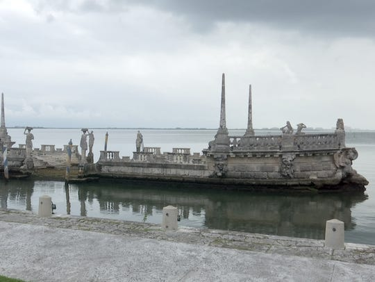 """The Barge"" sits in the water in front of Vizcaya,"