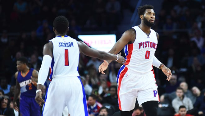 Detroit Pistons center Andre Drummond and guard Reggie Jackson, left, play against the Phoenix Suns at the Palace of Auburn Hills.