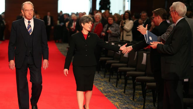U.S. Senators Charles Grassley, left, and Joni Ernst walk to their seats during the inauguration ceremony for Gov. Terry Branstad and Lt. Gov. Kim Reynolds on Friday, Jan. 16, 2015, in Des Moines, Iowa.