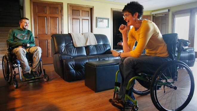 Samantha Schroth of Greenville shares a laugh with her friend, Alex Wallschlaeger, while hanging out at his house. Schroth was named Ms. Wheelchair America 2015 after competing in the national pageant in August.