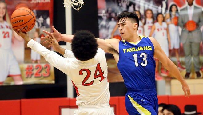 Moody's Mike Hernandez reaches for the ball against Ray's Kobe Chavana on Tuesday, Feb. 14, 2017, at Ray High School in Corpus Christi.