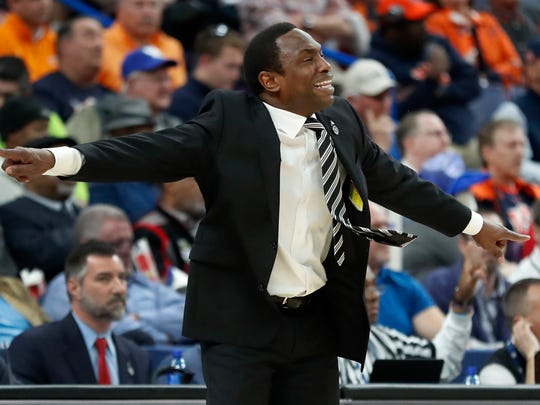 Alabama head coach Avery Johnson is seen on the sidelines during the second half in an NCAA college basketball quarterfinal game against Auburn at the Southeastern Conference tournament Friday, March 9, 2018, in St. Louis. Alabama won 81-63.