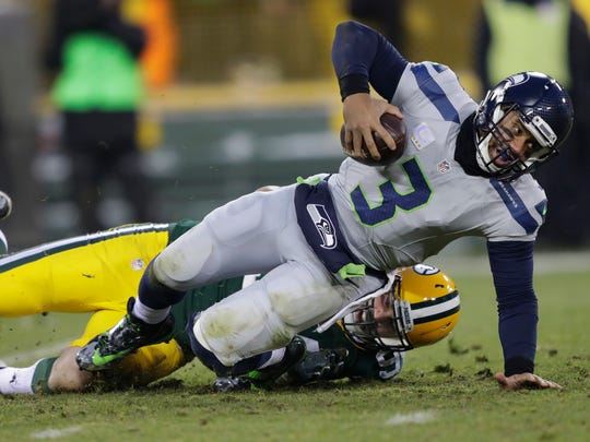 Green Bay Packers' Dean Lowry sacks Seattle Seahawks' Russell Wilson in the second quarter.  The Green Bay Packers host the Seattle Seahawks Sunday, December 11, 2016, at Lambeau Field in Green Bay, Wis.