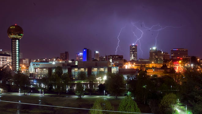Lightning strikes over downtown Knoxville on Wednesday, April 5, 2017.