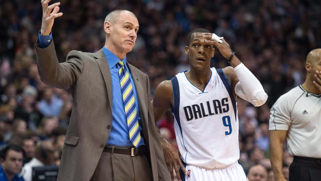 Dallas Mavericks head coach Rick Carlisle gives instructions to guard Rajon Rondo.