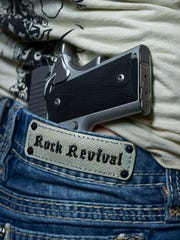 A Kimber .9mm pistol in her purse or the waistband