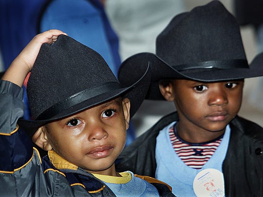 Decked out in black cowboy hats, Quincy's Jacquez Smith