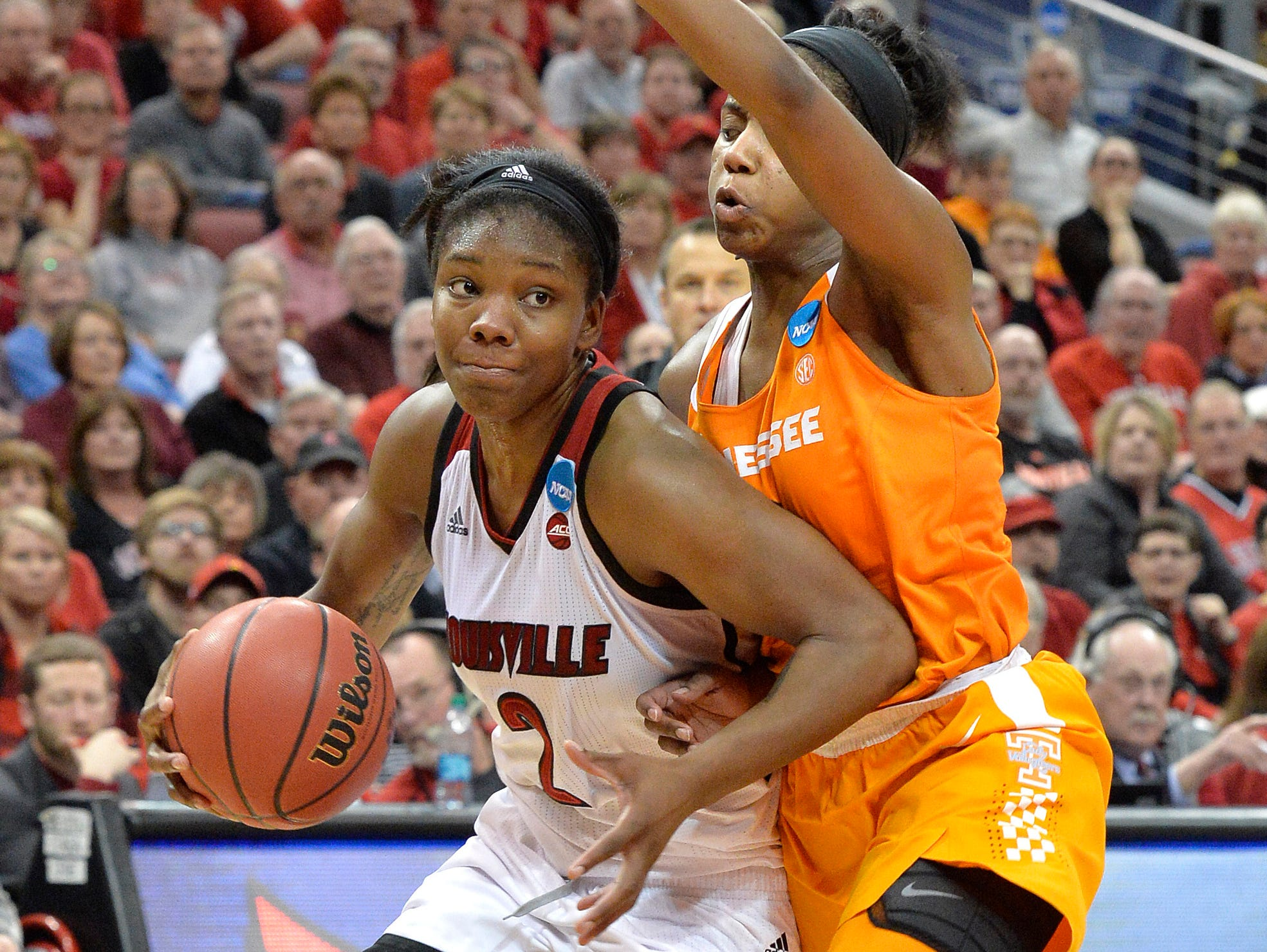 Louisville's Myisha Hines-Allen drives past Tennessee's Jordan Reynolds during the second half of Monday's second-round game in the NCAA women's college basketball tournament in Louisville, Ky. Louisville won 75-64.