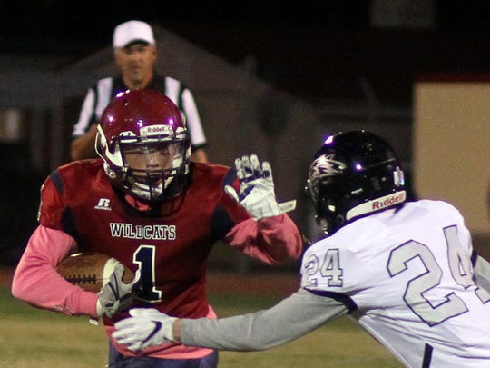 Senior Rylan Larko (1) looks for daylight after latching on to a Daniel Garcia pass.