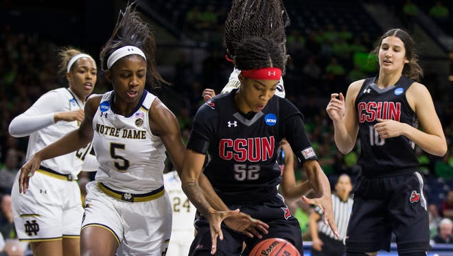 Notre Dame's Jackie Young (5) competes for the ball with Cal State Northridge's Eliza Matthews (52) during a first-round game in the NCAA women's college basketball tournament Friday, March 16, 2018, in South Bend, Ind.