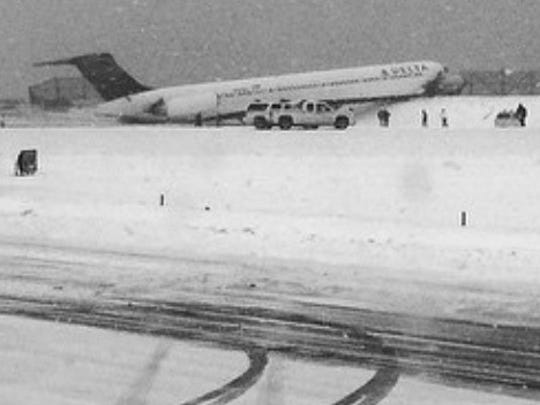 Delta Flight 1086 rests on a snowbank at LaGuardia
