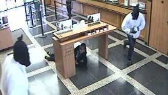 Surveillance photos from Moss Street bank robbery.
