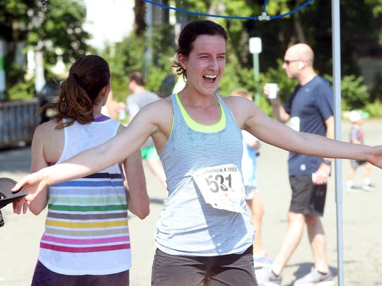 Meghan Crossman of Chatham cools off after finishing the Fishawack 4 Miler, part of the 46th Annual Chatham Fishawack Festival. June 10, 2017, Chatham, NJ.
