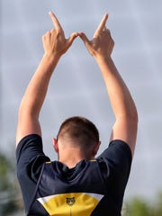 Chilton's Cody Gebhart holds up a 'W' after winning the Division 2 discus Friday at the WIAA state track and field meet in La Crosse.