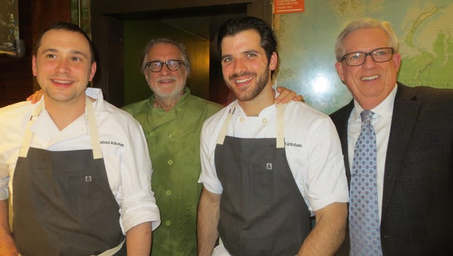 Justin Paterson, left, and Matt Kelly, third from left, of Hazelnut Kitchen, Trumansburg, joined Daňo Hutnik, second from left, of Daňo's Heuriger, Lodi, in the kitchen at the James Beard House in New York City on Friday. With them is David Blake, of Ulysses, a member of the Tompkins County Strategic Tourism Planning Board.