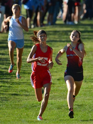 Paige Fassbender (left) of Slinger won this year's North Shore Conference title.