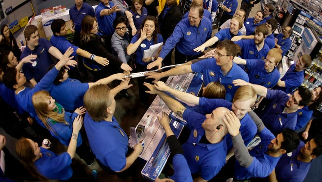 Best Buy employees rally after a pep talk as they prepare to open the store in Overland Park, Kan., to shoppers on Thursday.