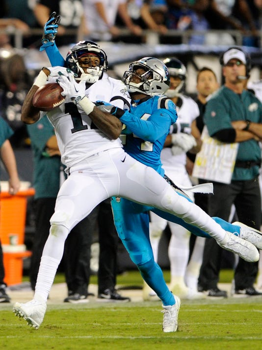 Philadelphia Eagles' Alshon Jeffery, left, misses a catch as Carolina Panthers' James Bradberry, right, defends in the second half of an NFL football game in Charlotte, N.C., Thursday, Oct. 12, 2017. (AP Photo/Mike McCarn)