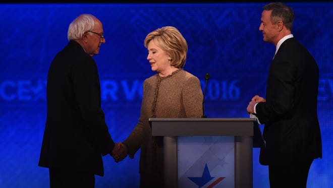 Bernie Sanders, Hillary Clinton and Martin O'Malley greet each other following the Democratic Presidential Debate hosted by ABC News at Saint Anselm College in Manchester, New Hampshire, on December 19, 2015.