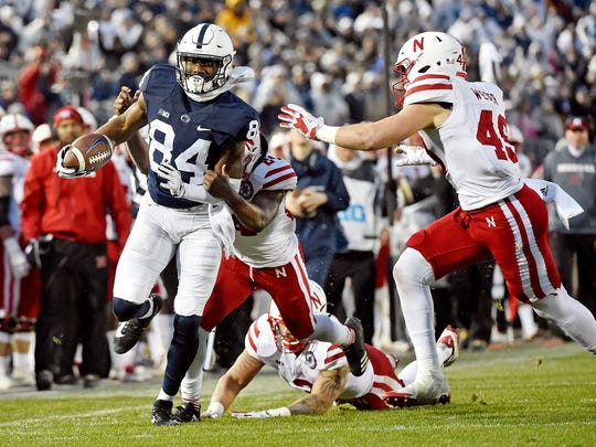 Penn State's Juwan Johnson carries the ball against Nebraska in the first half of an NCAA Division I football game Saturday, Nov. 18, 2017, at Beaver Stadium. Penn State defeated Nebraska 56-44 in its final home game of the 2017 season.