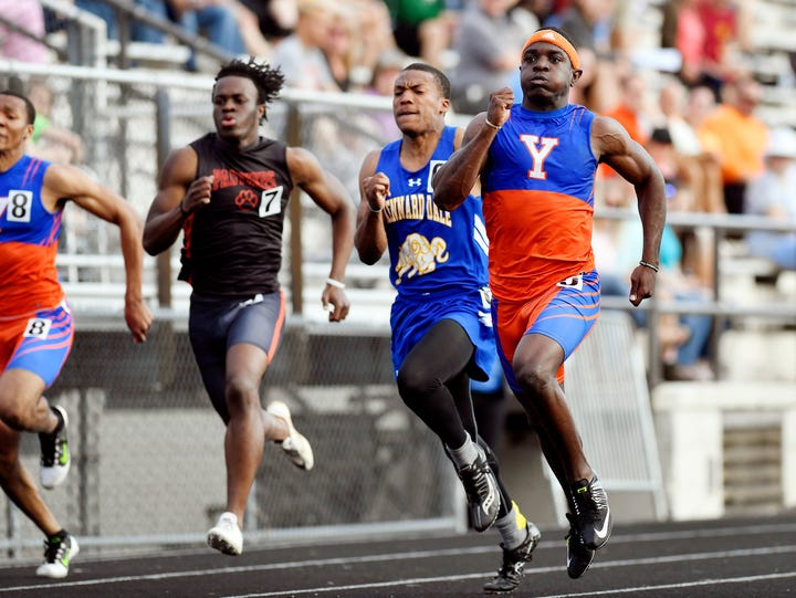York High's Khalid Dorsey, right, wins the 100-meter