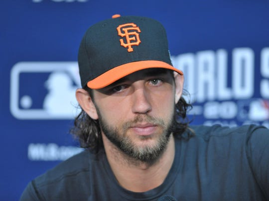 Oct 20, 2014; Kansas City, MO, USA; San Francisco Giants starting pitcher Madison Bumgarner (40) speaks to media during practice the day before the start of the 2014 World Series against the Kansas City Royals at Kauffman Stadium. Mandatory Credit: Denny Medley-USA TODAY Sports