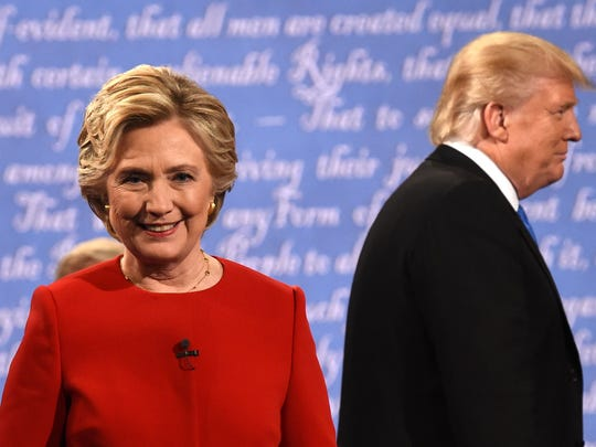 On Sept. 26, 2016 Democratic nominee Hillary Clinton and Republican nominee Donald Trump leave the stage after the first presidential debate at Hofstra University in Hempstead, New York.