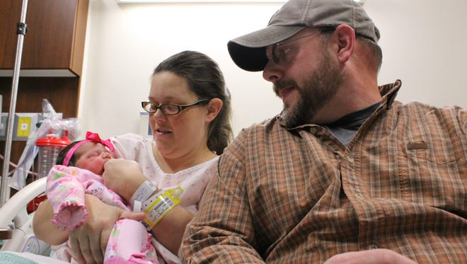 Erin and Todd Lemon, of Salem, comfort their newborn daughter, Hadley Amaya Blair Lemon. Hadley was born during the early morning hours Thursday in a car outside Baxter Regional Medical Center. The family barely made it to the hospital when she was born in freezing temperatures.