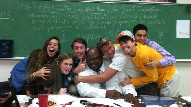 Leon High students pose for a photo with one of their favorite teachers, 52 year-old Rod Durham, who passed away this weekend.