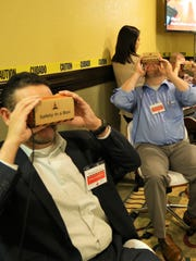 Texas Mutual Insurance's El Paso safety summit participants test the Safety-In-A-Box virtual reality safety training tool.