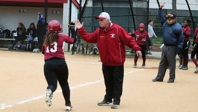 Bloomfield coach Bob Mayer congratulating Kristina Collins after she homered.