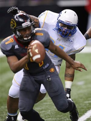 Grambling State quarterback Johnathan Williams (17) gets pressure from Southern University defensive lineman Thaddeus Hoffer during the second half of the Bayou Classic NCAA college football game in New Orleans, Saturday, Nov. 28, 2015. Grambling State won 34-23. (AP Photo/Max Becherer)