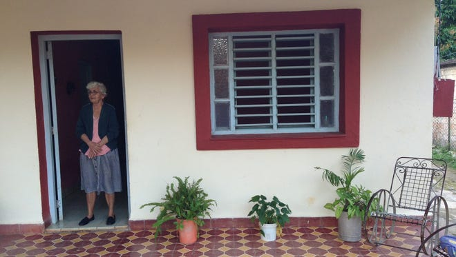 Carmen Ramirez Santa, 83, stands at the door of her home in Cojimar, Cuba, where she has lived since 1962.
