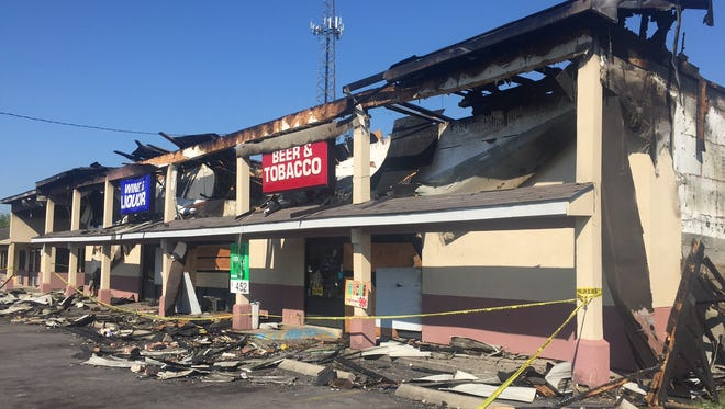 Fire destroyed the Broadway Wine & Liquor store late Monday night.