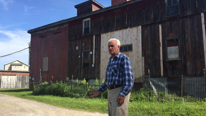 Rogers Powers Sr. tours the parcel on Schoen Place in Pittsford he hopes to sell to a developers who want to build a hotel.