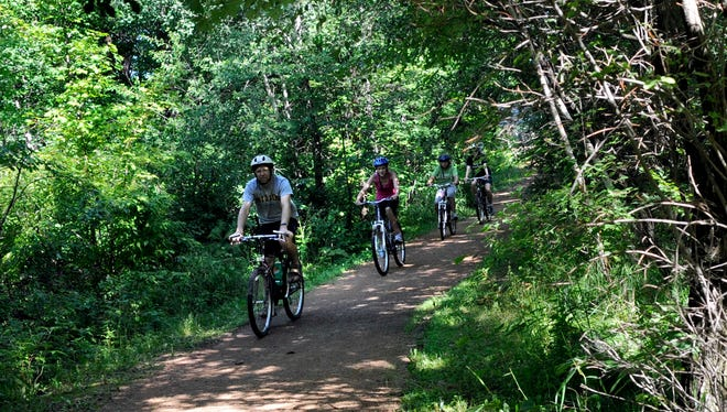 A family rides the Brickyard Trail portion of the Green Circle Trail south of Zenoff Park in Stevens Point.