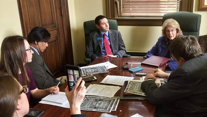 Rep. Nancy Ballance, R-Hamilton, upper right, and House Speaker Austin Knudsen, upper left, discuss 2017 legislative session with reporters on Tuesday.