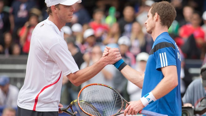 Andy Murray (GBR) shakes hands at the net with Sam Querrey (USA) after their match in the USA vs GBR Davis Cup tie at Petco Park.