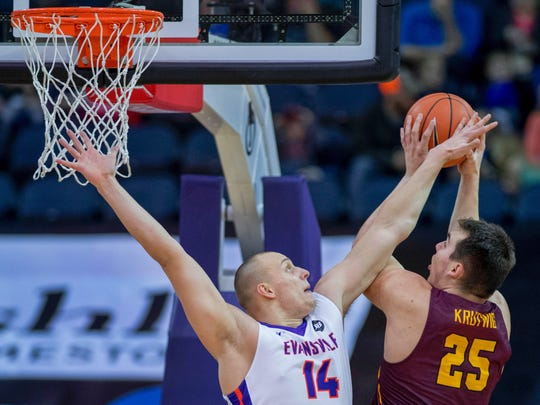 Evansville's Dainius Chatkevicius (14) blocks the shot of Loyola Chicago's Cameron Krutwig (25) during the first half of their game at the Ford Center Sunday afternoon.