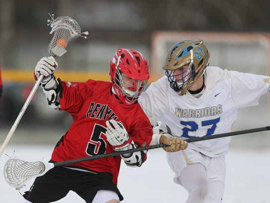 Schroeder's Erik Jakobsze (27) tries to keep Penfield's