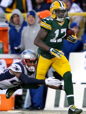 Green Bay Packers' Davante Adams tries to outrun New England Patriots' Darrelle Revis after catching a pass fro Aaron Rodgers earlier this season.