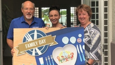 Mark Brechbill, CPA; Dr. Agnieszka Marshall, director of Tykes & Teens Prevention Services; and Holly Laiben, director of CHARACTER COUNTS! in Martin County, kick off Family Day, a campaign that encourages families to sit down to meals together.