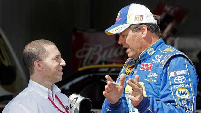 Rob Kauffman (left) speaks with Michael Waltrip, in 2008.