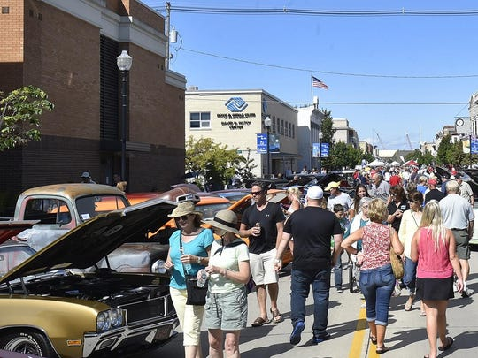 Visitors wander among the entries in the Old Bolts Car Club's annual Harvest Festival Classic Car Show, one of the festival's highlight events.