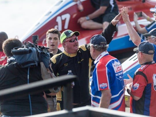 Greg Hopp (center), driver of the GP-12, receives a high-five after winning the APBA North American Grand Prix Championship during HydroFest at Dress Plaza on the Ohio River in Evansville, Ind., on Sunday, Sept. 3, 2017.