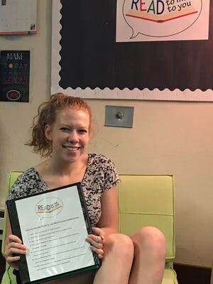 """Kohler Gold Award Girl Scout Kara Friske displays the """"READ to me, READ to you"""" child literacy program she developed as the final 80-hour project for her Girl Scout Gold Award, the nationally recognized highest award that a Girl Scout can earn."""