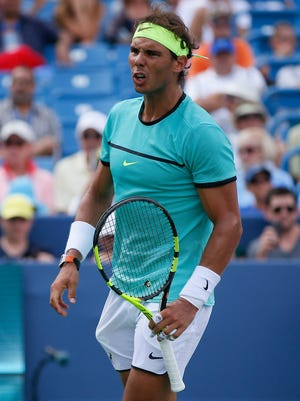 Rafael Nadal, of Spain, reacts after a missing point during the third-round match against Borna Coric, of Croatia, at the Western & Southern tennis tournament, Thursday, Aug. 18, 2016, at Lindner Family Tennis Center in Mason, Ohio.