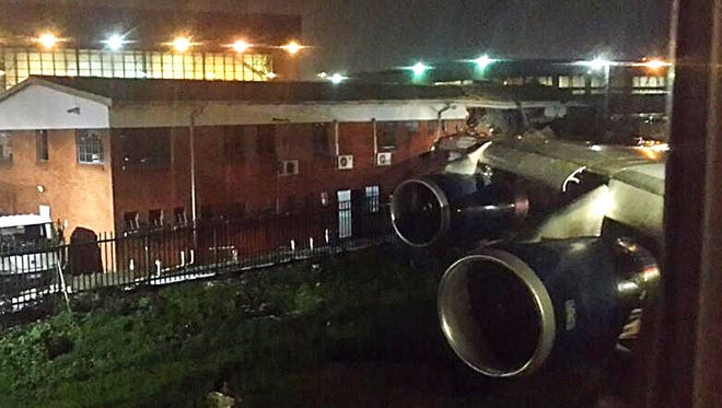 A picture released on Twitter shows the wing of a British Airways plane hitting an office building from a runway at Johannesburg's OR Tambo International Airport on Dec. 22, 2013.