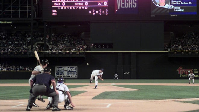 Diamondbacks pitcher Andy Benes throws the first pitch in Diamondbacks history to Rockies Mike Lansing at what was then-Bank One Ballpark (now Chase Field).