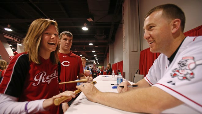 Courtney Cann, of Milan, Indiana is all smiles as she gets an autograph from Todd Frazier at the 2013 Redsfest held at the Duke Energy Convention Center in downtown Cincinnati Dec. 6, 2013. Jen Mullert writes to say that Reds fans should be willing to give ballplayers respect and space as they represent the city.